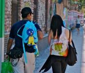 Couple walking in the Bellas Artes area of Santiago, Chile 2010-12-26