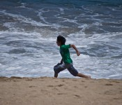 Child running on the beach in Viña del Mar, Chile 2012-01-07