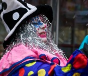 Bustling clown at Yorkville IceFest on Cumberland Street, Toronto 2011-02-26