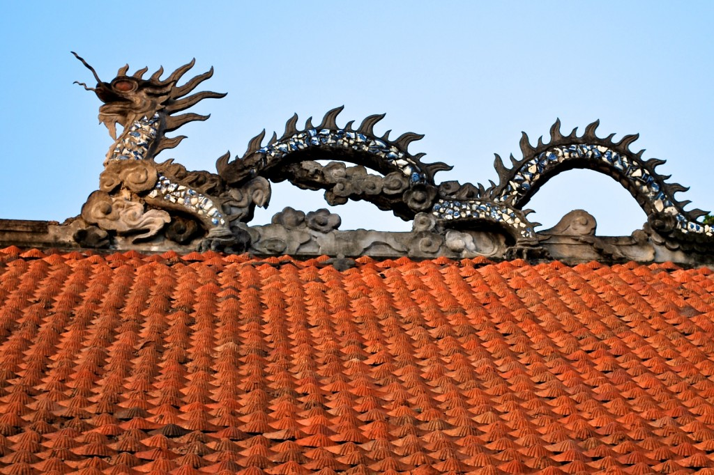 Ornate details of a rooftop at the Temple of Literature, Hanoi, Vietnam