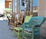 Chairs and spinning wheel for sale on rue Notre Dame in Lachine